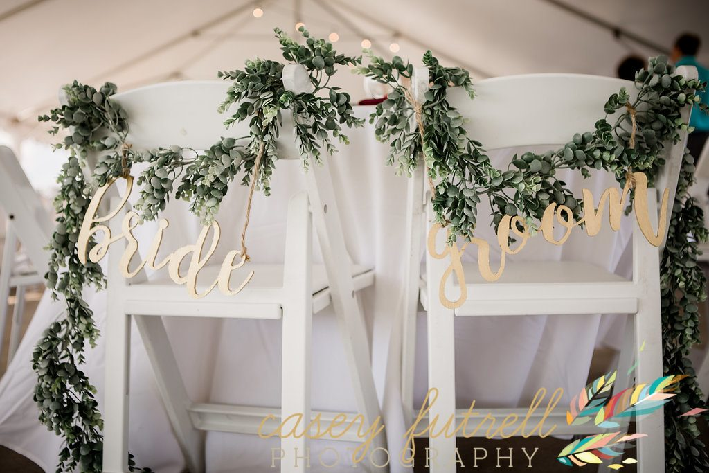 Sweetheart table wedding details. Swag with gold signage