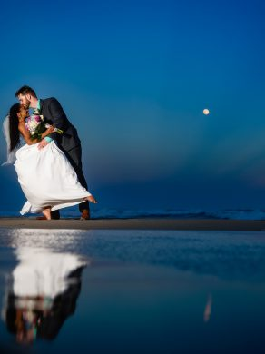 Bride and groom, evening portrait, oceanfront image,