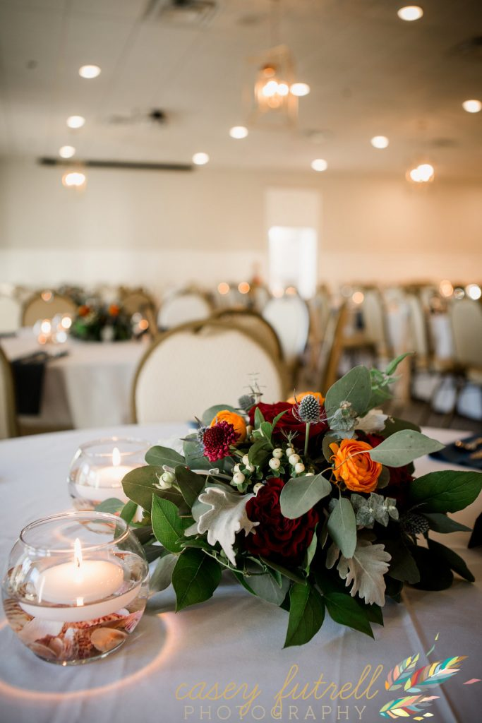 candle light reception with red and orange centerpieces