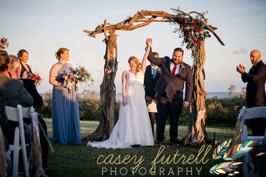 Bride and Groom driftwood arbor, oceanfront ceremony