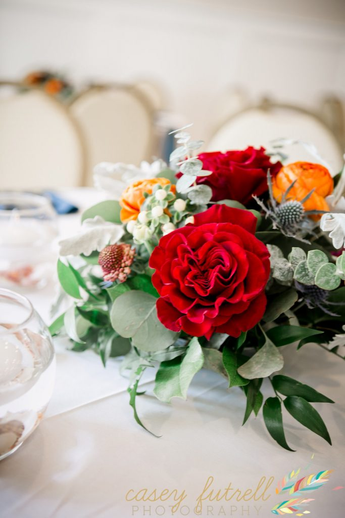 Red, green, and burnt orange centerpiece design