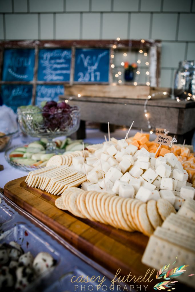 Assorted cheese and cracker boards, cocktail food, reception food