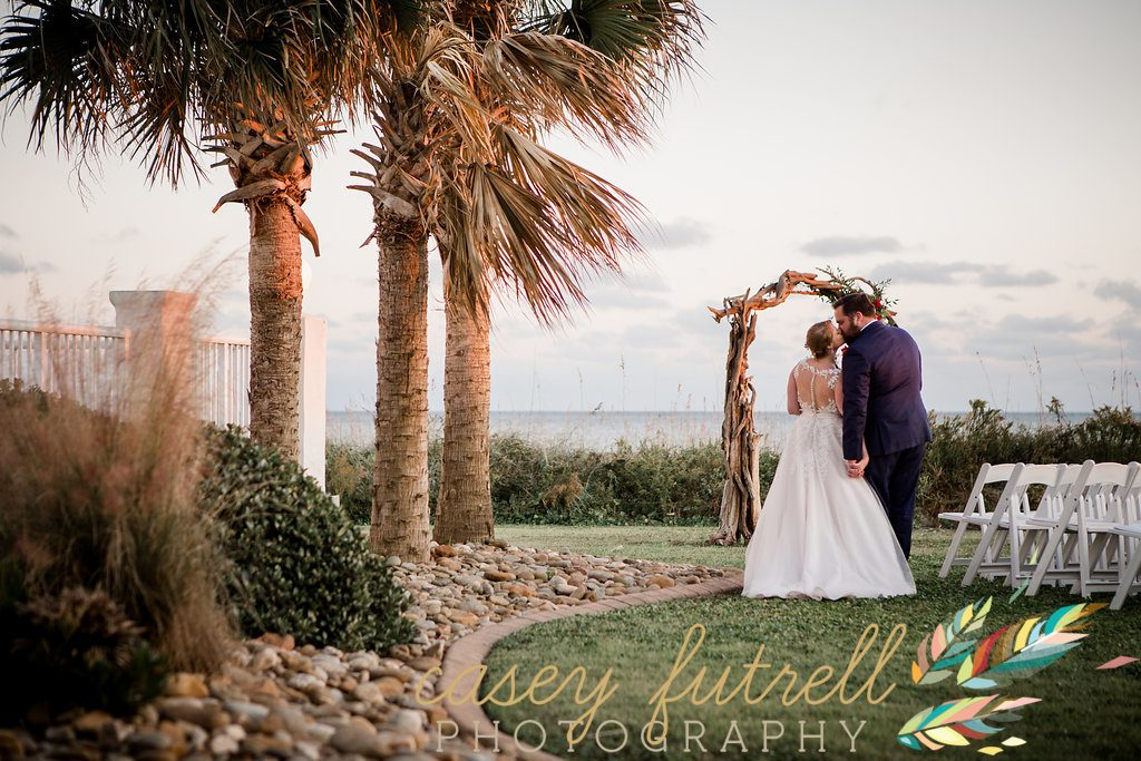 Oceanfront ceremony, oceanfront bride and groom, driftwood arbor